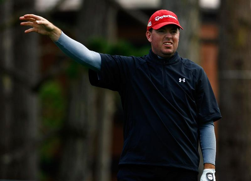 PEBBLE BEACH, CA - FEBRUARY 12:  Robert Garrigus gestures right after hitting an errant tee shot on the 18th hole during the first round of the AT&T Pebble Beach National Pro-Am at the Spyglass Hill Golf Course on February 12, 2009 in Pebble Beach, California.  (Photo by Jeff Gross/Getty Images)