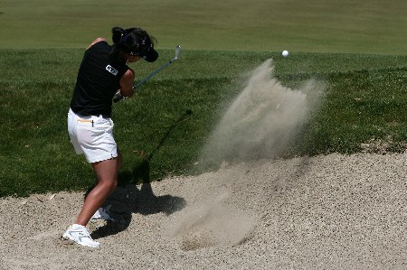 RANCHO MIRAGE, CA - MARCH 31:  Mi Hyun Kim of South Korea makes a shot out of the bunker during the third round of the LPGA Kraft Nabisco Championship at the Mission Hills Country Club on March 31, 2007 in Rancho Mirage, California.  (Photo by Robert Laberge/Getty Images)
