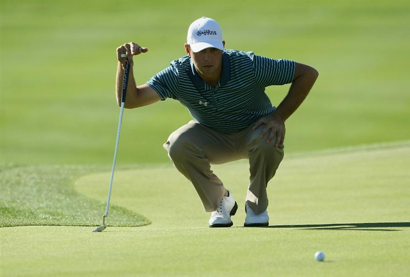 LA QUINTA, CA - JANUARY 22:  Gary Woodland lines up a putt on the 11th green during the fourth round of the Bob Hope Classic at the Palmer Private course at PGA West on January 22, 2011 in La Quinta, California.  (Photo by Jeff Gross/Getty Images)