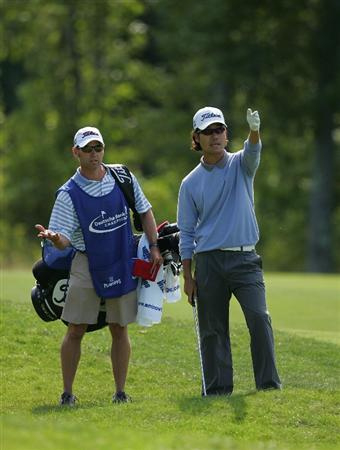 NORTON, MA - SEPTEMBER 06:  Kevin Na prepares to play his second shot from the rough on the 15th hole during the third round of the Deutsche Bank Championship at TPC Boston held on September 6, 2009 in Norton, Massachusetts.  (Photo by Michael Cohen/Getty Images)