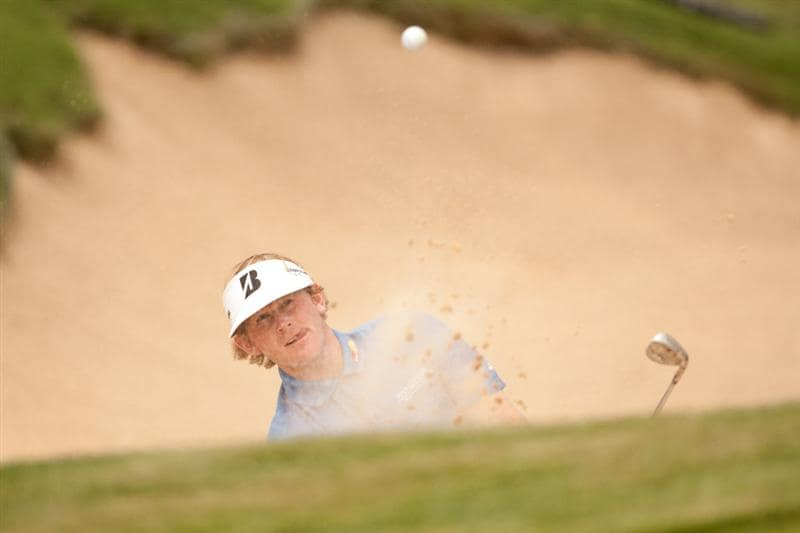 SAN ANTONIO, TX - APRIL 17: Brandt Snedeker follows through on a bunker shot during the final round of the Valero Texas Open at the AT&T Oaks Course at TPC San Antonio on April 17, 2011 in San Antonio, Texas. (Photo by Darren Carroll/Getty Images)
