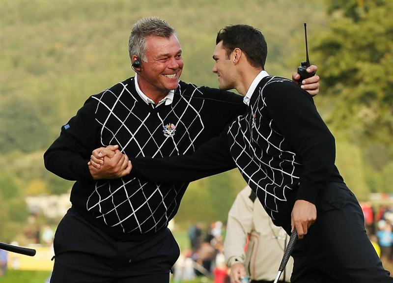 NEWPORT, WALES - OCTOBER 03:  Martin Kaymer of Europe celebrates with Vice Captain Darren Clarke (L) on the 17th green after winning his match during the  Fourball & Foursome Matches during the 2010 Ryder Cup at the Celtic Manor Resort on October 3, 2010 in Newport, Wales.  (Photo by Ross Kinnaird/Getty Images)