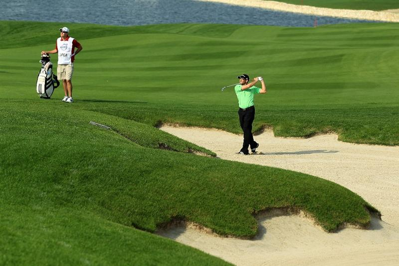 BAHRAIN, BAHRAIN - JANUARY 27:  Sergio Garcia of Spain plays his second shot at the 17th hole during the first round of the 2011 Volvo Champions held at the Royal Golf Club on January 27, 2011 in Bahrain, Bahrain.  (Photo by David Cannon/Getty Images)
