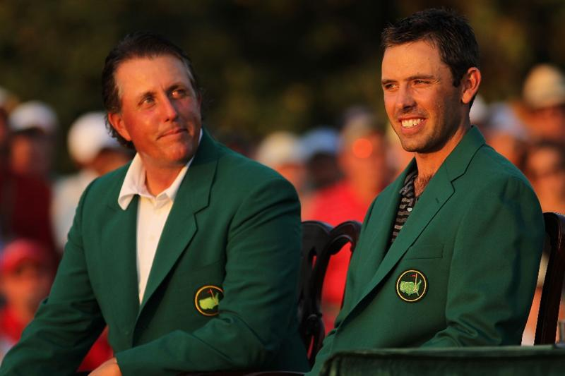 AUGUSTA, GA - APRIL 10:  Phil Mickelson (L) and Charl Schwartzel of South Africa (R) are seen at the green jacket presentation after Schwartzel's two-stroke victory at the 2011 Masters Tournament at Augusta National Golf Club on April 10, 2011 in Augusta, Georgia.  (Photo by Jamie Squire/Getty Images)