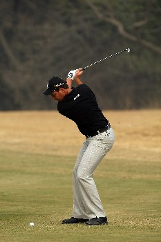 DELHI, INDIA - FEBRUARY 05:  David Howell of England hits his second shot to the 12th green during the Challenge Match, in the Emaar-MGF Indian Masters at the Delhi Golf Club on February 5, 2008 in Delhi, India.  (Photo by David Cannon/Getty Images)