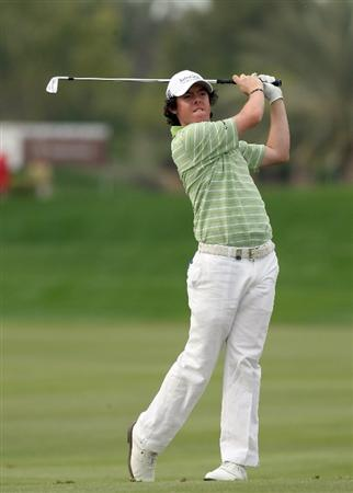 ABU DHABI, UNITED ARAB EMIRATES - JANUARY 18:  Rory McIlroy of Northern Ireland hits his second shot at the 14th hole during the final round of the Abu Dhabi Golf Championship held at the Abu Dhabi Golf Club on January 18, 2009 in Abu Dhabi, United Arab Emirates  (Photo by David Cannon/Getty Images)