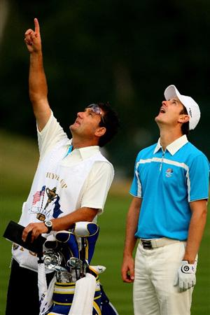 LOUISVILLE, KY - SEPTEMBER 20:  Justin Rose of the European team chats with his caddie Mark Fulcher  during the morning foursome matches on day two of the 2008 Ryder Cup at Valhalla Golf Club on September 20, 2008 in Louisville, Kentucky.  (Photo by Andrew Redington/Getty Images)