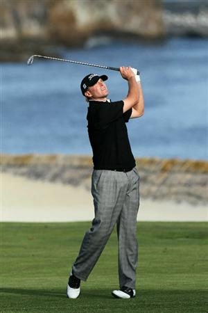 PEBBLE BEACH, CA - JUNE 17:  Steve Stricker hits a shot on the 18th hole during the first round of the 110th U.S. Open at Pebble Beach Golf Links on June 17, 2010 in Pebble Beach, California.  (Photo by Stephen Dunn/Getty Images)