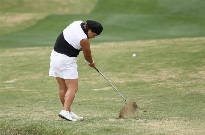 PHOENIX, AZ - MARCH 20:  Christina Kim hits her second shot on the eighth hole during the final round of the RR Donnelley LPGA Founders Cup at Wildfire Golf Club on March 20, 2011 in Phoenix, Arizona.  (Photo by Stephen Dunn/Getty Images)