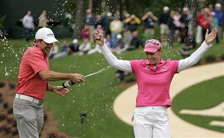 WILLIAMSBURG, VA - MAY 11:  Annika Sorenstam of Sweden (R) gets sprayed with beer by Mike McGee, Managing Director of Annika Academy, after winning the Michelob Ultra Open at Kingsmill Resort & Spa on May 11, 2008 in Williamsburg, Virginia. (Photo by Hunter Martin/Getty Images)