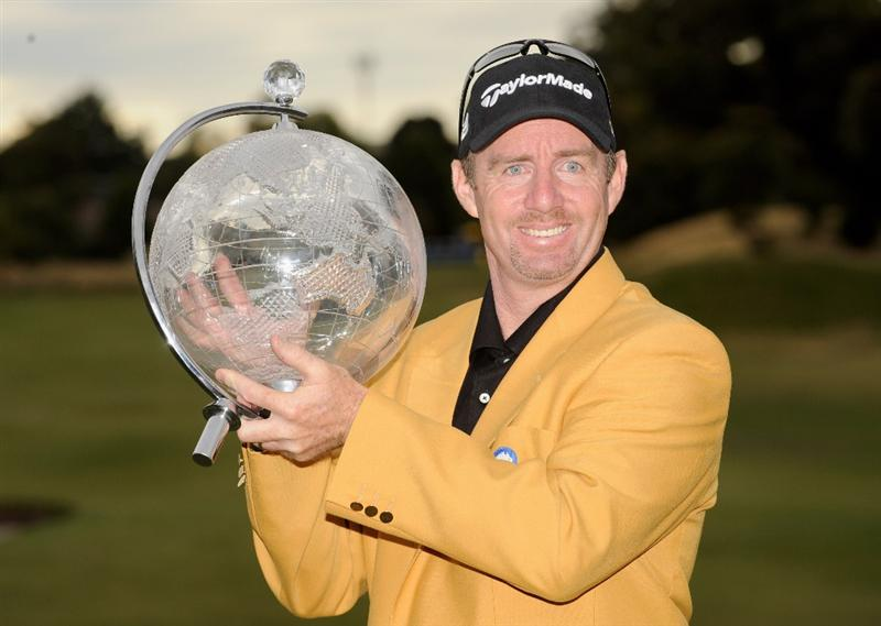MELBOURNE, AUSTRALIA - NOVEMBER 30:  Rod Pampling of Australia holds aloft the winners trophy after winning the 2008 Australian Masters at Huntingdale Golf Club on November 30, 2008 in Melbourne, Australia  (Photo by Robert Cianflone/Getty Images)