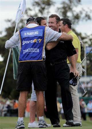 MELBOURNE, AUSTRALIA - NOVEMBER 30:  Rod Pampling of Australia celebrates with his caddy after winning the 2008 Australian Masters at Huntingdale Golf Club on November 30, 2008 in Melbourne, Australia  (Photo by Robert Cianflone/Getty Images)