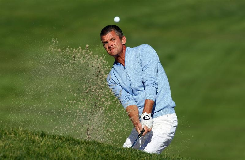 LA JOLLA, CA - JANUARY 28:  Jesper Parnevik of Sweden hits out of the bunker on the 14th hole during the second round of the Farmers Insurance Open at Torrey Pines on January 28, 2011 in La Jolla, California. (Photo by Donald Miralle/Getty Images)