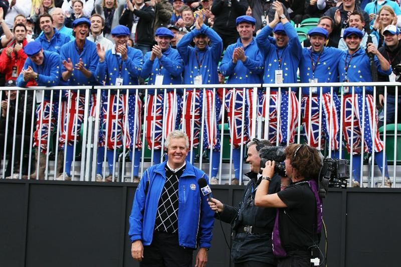 NEWPORT, WALES - OCTOBER 02:  Europe Team Captain Colin Montgomerie is interviewed by Tim Barter of Sky TV in front of a group of Ryder Cup fans on the first tee during the  Fourball & Foursome Matches during the 2010 Ryder Cup at the Celtic Manor Resort on October 2, 2010 in Newport, Wales.  (Photo by David Cannon/Getty Images)