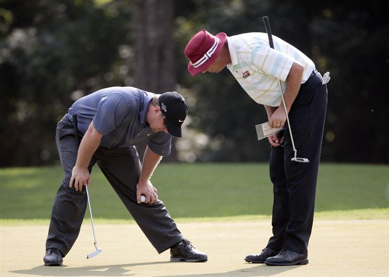 MADISON, MS - SEPTEMBER 18:  David Duval, left, and Kirk Triplett study a mark on the 7th green during first round play in the Viking Classic at the Annandale Golf Club on September 18, 2008 in  Madison, Mississippi.  (Photo by Dave Martin/Getty Images)