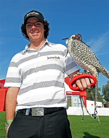 ABU DHABI, UNITED ARAB EMIRATES - JANUARY 19:  Rory McIlroy of Northern Ireland poses for a photograph with a falcon on his arm during a photocall at The Abu Dhabi Golf Championship at Abu Dhabi Golf Club on January 19, 2010 in Abu Dhabi, United Arab Emirates.  (Photo by Andrew Redington/Getty Images)