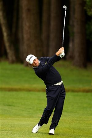 VIRGINIA WATER, ENGLAND - MAY 27:  Graeme McDowell of Northern Ireland hits an approach shot on the 12th hole during the second round of the BMW PGA Championship at the Wentworth Club on May 27, 2011 in Virginia Water, England.  (Photo by Richard Heathcote/Getty Images)