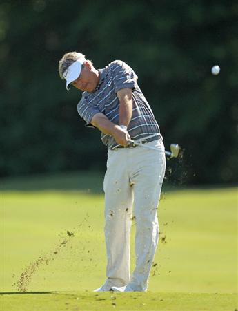 LUTZ, FL - APRIL 17:  John Cook hits his approach shot on the  second hole during the final round of the Outback Steakhouse Pro-Am at the TPC of Tampa on April 17, 2011 in Lutz, Florida.  (Photo by Mike Ehrmann/Getty Images)