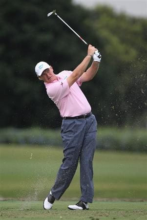 DORAL, FL - MARCH 10:  Ernie Els of South Africa hits his tee shot on the ninth hole during the first round of the 2011 WGC- Cadillac Championship at the TPC Blue Monster at the Doral Golf Resort and Spa on March 10, 2011 in Doral, Florida.  (Photo by Sam Greenwood/Getty Images)