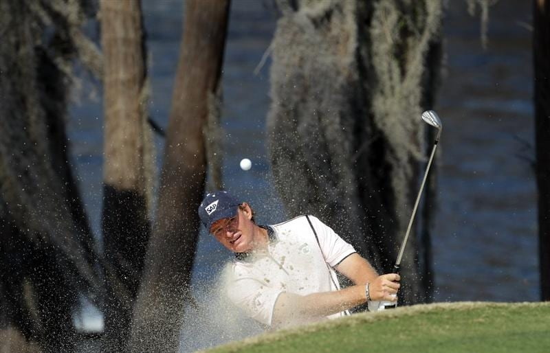 WINDERMERE, FL - MARCH 15:  Ernie Els of South Africa and the Albany Club playing his second shot at the 2nd hole during the second day of the 2011 Tavistock Cup at Isleworth Golf and Country Club on March 15, 2011 in Windermere, Florida.  (Photo by David Cannon/Getty Images)
