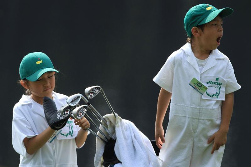 AUGUSTA, GA - APRIL 07:  Daniel (R) and Amanda Choi watch the play of their father K.J. Choi during the Par 3 Contest prior to the 2010 Masters Tournament at Augusta National Golf Club on April 7, 2010 in Augusta, Georgia.  (Photo by David Cannon/Getty Images)