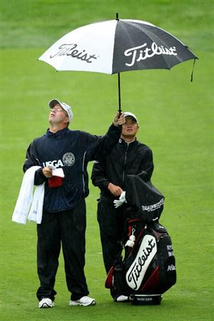 FARMINGDALE, NY - JUNE 18:  Ryuji Imada of Japan waits with his caddie Casey Kellog on the second hole during the first round of the 109th U.S. Open on the Black Course at Bethpage State Park on June 18, 2009 in Farmingdale, New York.  (Photo by Ross Kinnaird/Getty Images)