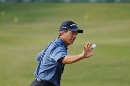 Jerry Pate grabs a ball on the driving range before  the first round of  the 2005 Bruno's Memorial Classic, May 20, in Hoover, Al.Photo by Al Messerschmidt/WireImage.com
