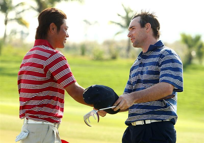 BANGKOK, THAILAND - JANUARY 11:  Hideto Tanihara congratulates Oliver Wilson of England during The Royal Trophy at the Amata Spring Country Club on January 11, 2009 in Bangkok, Thailand.  (Photo by Ian Walton/Getty Images)