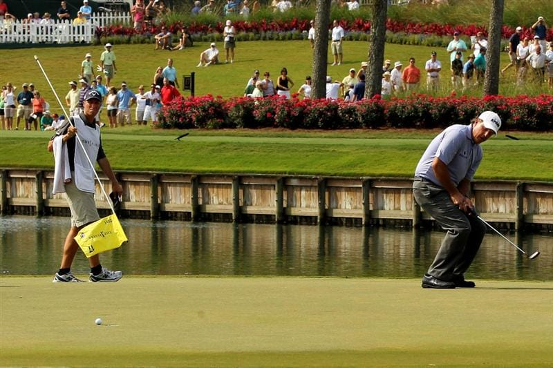 PONTE VEDRA BEACH, FL - MAY 13:  Phil Mickelson reacts to a missed putt on the 17th hole during the second round of THE PLAYERS Championship held at THE PLAYERS Stadium course at TPC Sawgrass on May 13, 2011 in Ponte Vedra Beach, Florida.  (Photo by Mike Ehrmann/Getty Images)