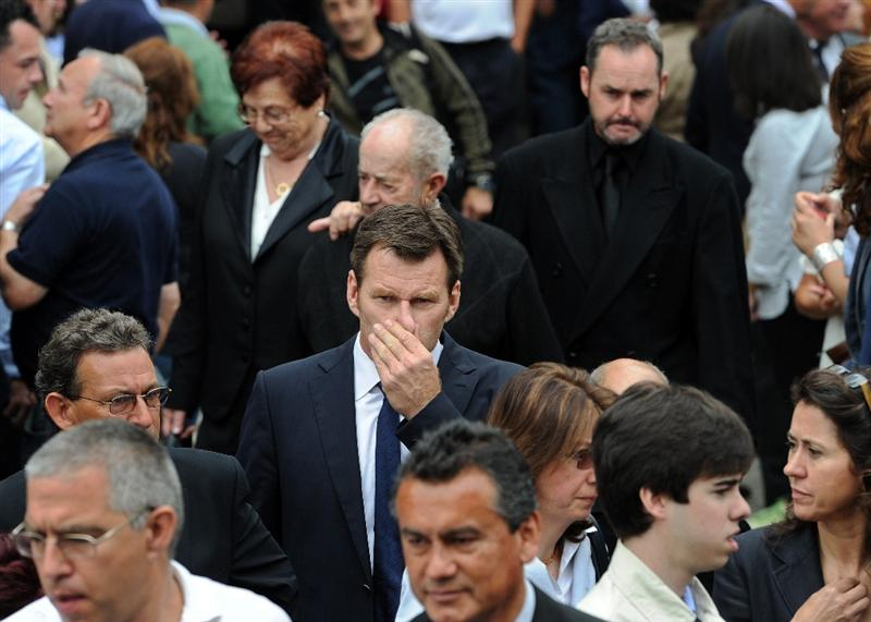 PEDRENA, SPAIN - MAY 11:  Golfer Sir Nick Faldo (C) of England leaves the funeral service held for legendary Spanish golfer Seve Ballesteros on May 11, 2011 in Pedrena, Spain. Top-ranked golf players have joined family members and friends to pay their last respects to the late golf great, who died on May 7, 2011 from complications arising from a brain tumor, in his home town parish church.  (Photo by Jasper Juinen/Getty Images)