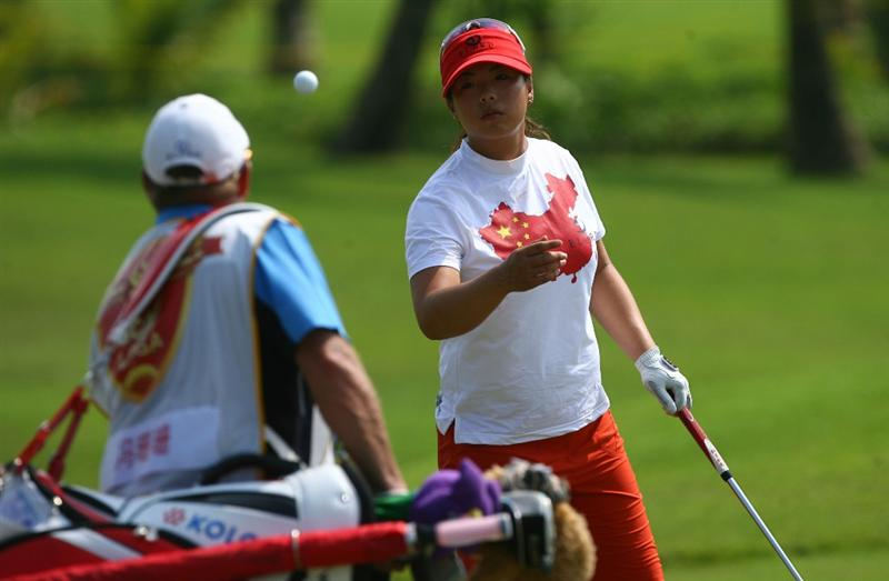 HAIKOU, CHINA - OCTOBER 24: (CHINA OUT) Feng Shanshan (R) of China on the 10th hole during day one of the Grand China Air LPGA 2008 on October 24, 2008 in Haikou of Hainan Province, China. (Photo by China Photos/Getty Images)
