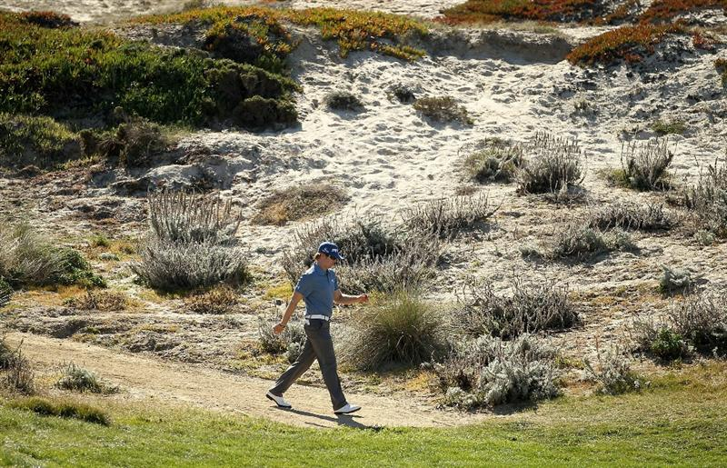 PEBBLE BEACH, CA - FEBRUARY 10:  Hunter Mahan walks down to the 3rd hole green at the Spyglass Hill Golf Course during Round One of the AT&T Pebble Beach National Pro-Am on February 10, 2011 in Pebble Beach, California.  (Photo by Ezra Shaw/Getty Images)
