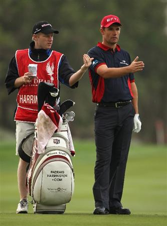 ABU DHABI, UNITED ARAB EMIRATES - JANUARY 15:  Padraig Harrington of Ireland and his caddie Ronan Flood judge the wind on the 13th hole during the first round of The Abu Dhabi Golf Championship at Abu Dhabi Golf Club on January 15, 2009 in Abu Dhabi, United Arab Emirates.  (Photo by Andrew Redington/Getty Images)