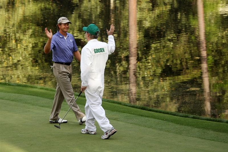 AUGUSTA, GA - APRIL 07:  Retief Goosen of South Africa celebrates with his caddie during the Par 3 Contest prior to the 2010 Masters Tournament at Augusta National Golf Club on April 7, 2010 in Augusta, Georgia.  (Photo by Andrew Redington/Getty Images)