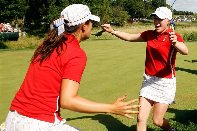 SUGAR GROVE, IL - AUGUST 23:  Morgan Pressel is greeted on the 16th green by Michelle Wie after Pressel clinched the 2009 Solheim Cup for the U.S. Team against the European Team during the Sunday singles matches at Rich Harvest Farms on August 23, 2009 in Sugar Grove, Illinois.   (Photo by Chris Graythen/Getty Images)