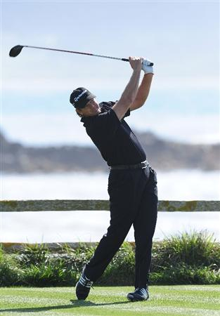 PEBBLE BEACH, CA - FEBRUARY 12:  Retief Goosen of South Africa plays his tee shot on the 18th hole during round two of the AT&T Pebble Beach National Pro-Am at Pebble Beach Golf Links on February 12, 2010 in Pebble Beach, California.  (Photo by Stuart Franklin/Getty Images)