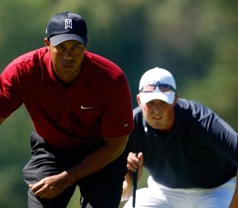 LEMONT, IL - SEPTEMBER 13:  Tiger Woods (L) and Marc Leishman of Australia line up their putts on the fifth green during the final round of the BMW Championship held at Cog Hill Golf & CC on September 13, 2009 in Lemont, Illinois.  (Photo by Scott Halleran/Getty Images)