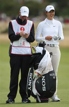 LYTHAM ST ANNES, ENGLAND - JULY 31:  Michelle Wie of USA waits with her caddie during the second round of the 2009 Ricoh Women's British Open Championship held at Royal Lytham St Annes Golf Club, on July 31, 2009 in  Lytham St Annes, England.  (Photo by David Cannon/Getty Images)