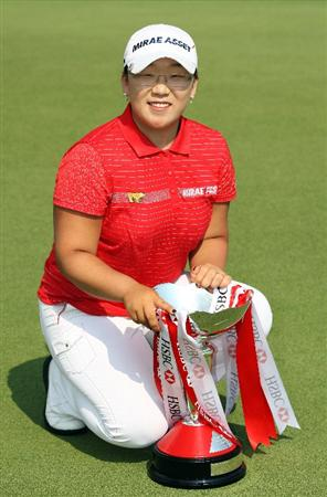 SINGAPORE - MARCH 08:  Jiyai Shin of South Korea with the winners trophy the final round of HSBC Women's Champions at the Tanah Merah Country Club on March 8, 2009 in Singapore.  (Photo by Ross Kinnaird/Getty Images)