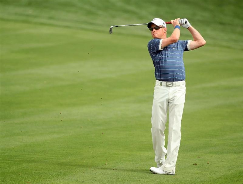 DUBAI, UNITED ARAB EMIRATES - FEBRUARY 04:  Simon Dyson of England plays his second shot to the par 4, 8th hole during the first round of the 2010 Omega Dubai Desert Classic on the Majilis Course at the Emirates Golf Club on February 4, 2010 in Dubai, United Arab Emirates.  (Photo by David Cannon/Getty Images)
