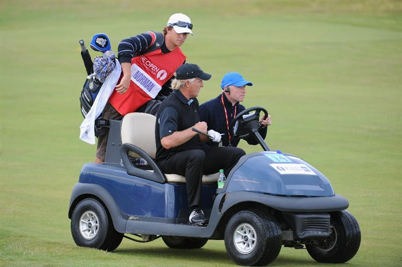 TURNBERRY, SCOTLAND - JULY 16:  Greg Norman of Australia rides a cart with his son/caddie Gregory after losing his ball on the fifth hole during round one of the 138th Open Championship on the Ailsa Course, Turnberry Golf Club on July 16, 2009 in Turnberry, Scotland.  (Photo by Harry How/Getty Images)