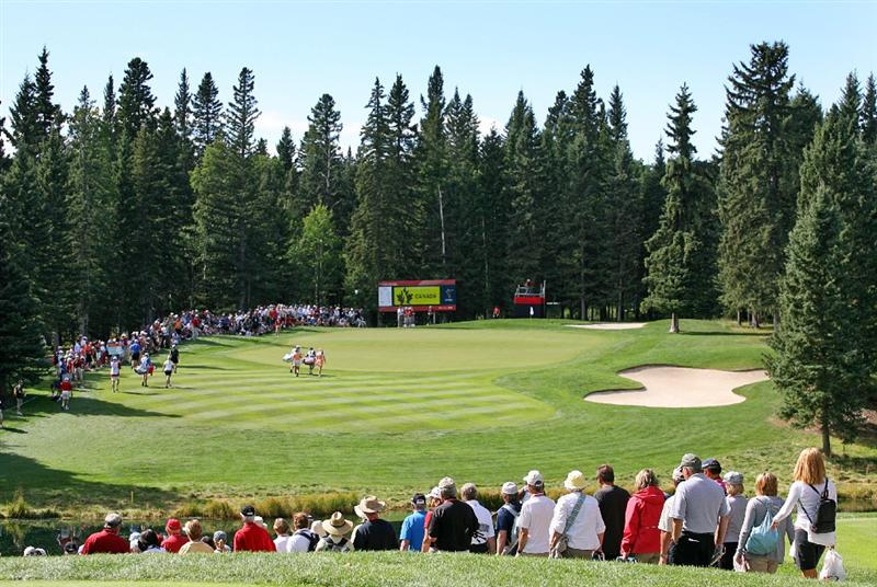 CALGARY, AB - SEPTEMBER 04 : A scenic view of the par 3 eighth hole as fans walk down to the green during the second round of the Canadian Women's Open at Priddis Greens Golf & Country Club on September 4, 2009 in Calgary, Alberta, Canada. (Photo by Hunter Martin/Getty Images)