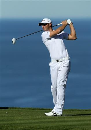 LA JOLLA, CA - JANUARY 27:  Dustin Johnson hits his tee shot on the fifth hole during round one of the Farmers Insurance Open at Torrey Pines North Course on January 27, 2011 in La Jolla, California.  (Photo by Stephen Dunn/Getty Images)