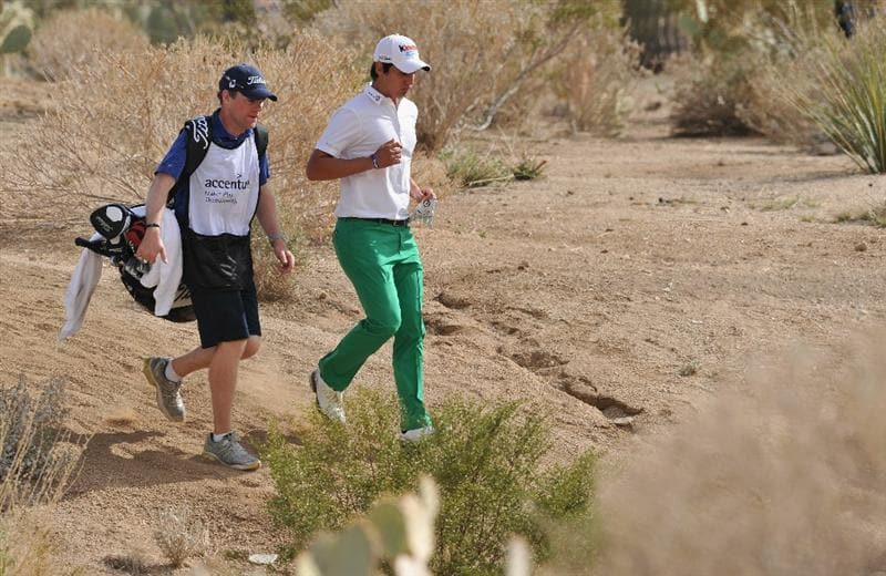 MARANA, AZ - FEBRUARY 25:  Matteo Manassero of Italy and caddie Ryan McGuigan walk during the third round of the Accenture Match Play Championship at the Ritz-Carlton Golf Club on February 25, 2011 in Marana, Arizona.  (Photo by Stuart Franklin/Getty Images)