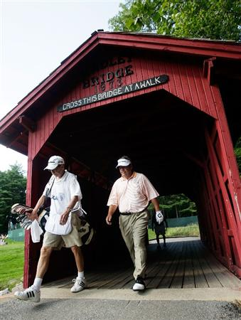 CARMEL, IN - JULY 31:  Joey Sindelar of the USA crosses a covered bridge between the 6th and 7th holes during the second round of the 2009 U.S. Senior Open on July 31, 2009 at Crooked Stick Golf Club in Carmel, Indiana.  (Photo by Jamie Squire/Getty Images)