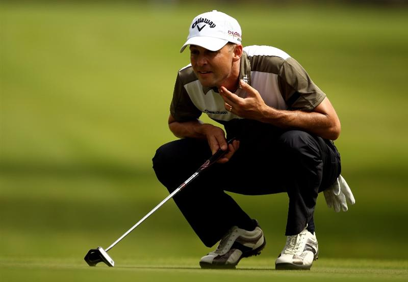 RABAT, MOROCCO - MARCH 18:  Niclas Fasth of Sweden lines up a putt during the first round of the Hassan II Golf Trophy at Royal Golf Dar Es Salam on March 18, 2010 in Rabat, Morocco.  (Photo by Richard Heathcote/Getty Images)