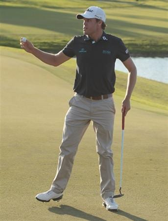 DORAL, FL - MARCH 13:  Nick Watney celebrates his birdie putt on the 18th green during the final round of the 2011 WGC- Cadillac Championship at the TPC Blue Monster at the Doral Golf Resort and Spa on March 13, 2011 in Doral, Florida.  (Photo by Scott Halleran/Getty Images)