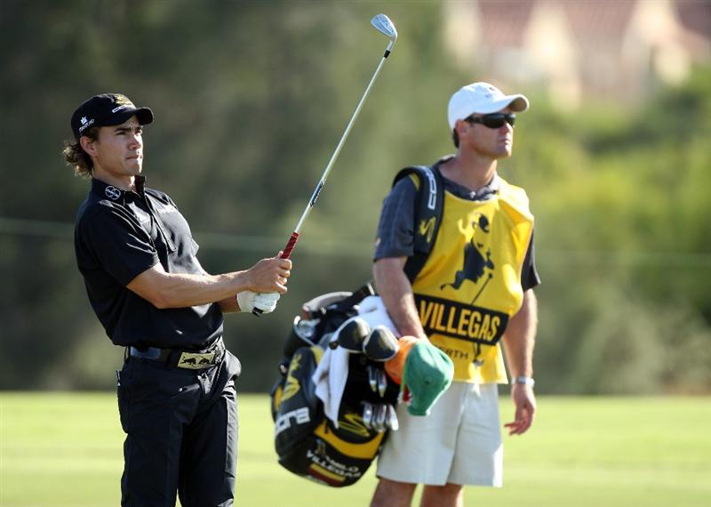 PERTH, AUSTRALIA - FEBRUARY 17:  Camilo Villegas of Colombia hits his second shot at the 18th hole during the Pro-Celebrity event in aid of the Victorian Bush Fires Red Cross Appeal as a preview for the 2009 Johnnie Walker Classic tournament at the Vines Resort and Country Club on February 17, 2009 in Perth, Australia  (Photo by David Cannon/Getty Images)