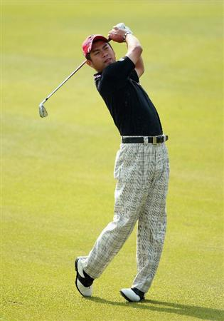 SHANGHAI, CHINA - NOVEMBER 05:  Yuta Ikeda of Japan watches his approach shot on the first hole during the second round of the WGC-HSBC Champions at Sheshan International Golf Club on November 5, 2010 in Shanghai, China.  (Photo by Andrew Redington/Getty Images)