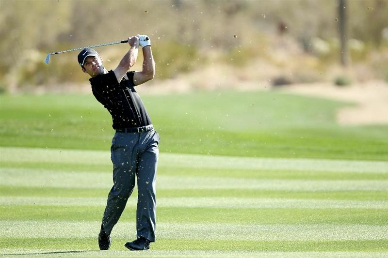 MARANA, AZ - FEBRUARY 24:  Paul Casey of England hits his second shot on the second hole during the second round of the Accenture Match Play Championship at the Ritz-Carlton Golf Club on February 24, 2011 in Marana, Arizona.  (Photo by Andy Lyons/Getty Images)